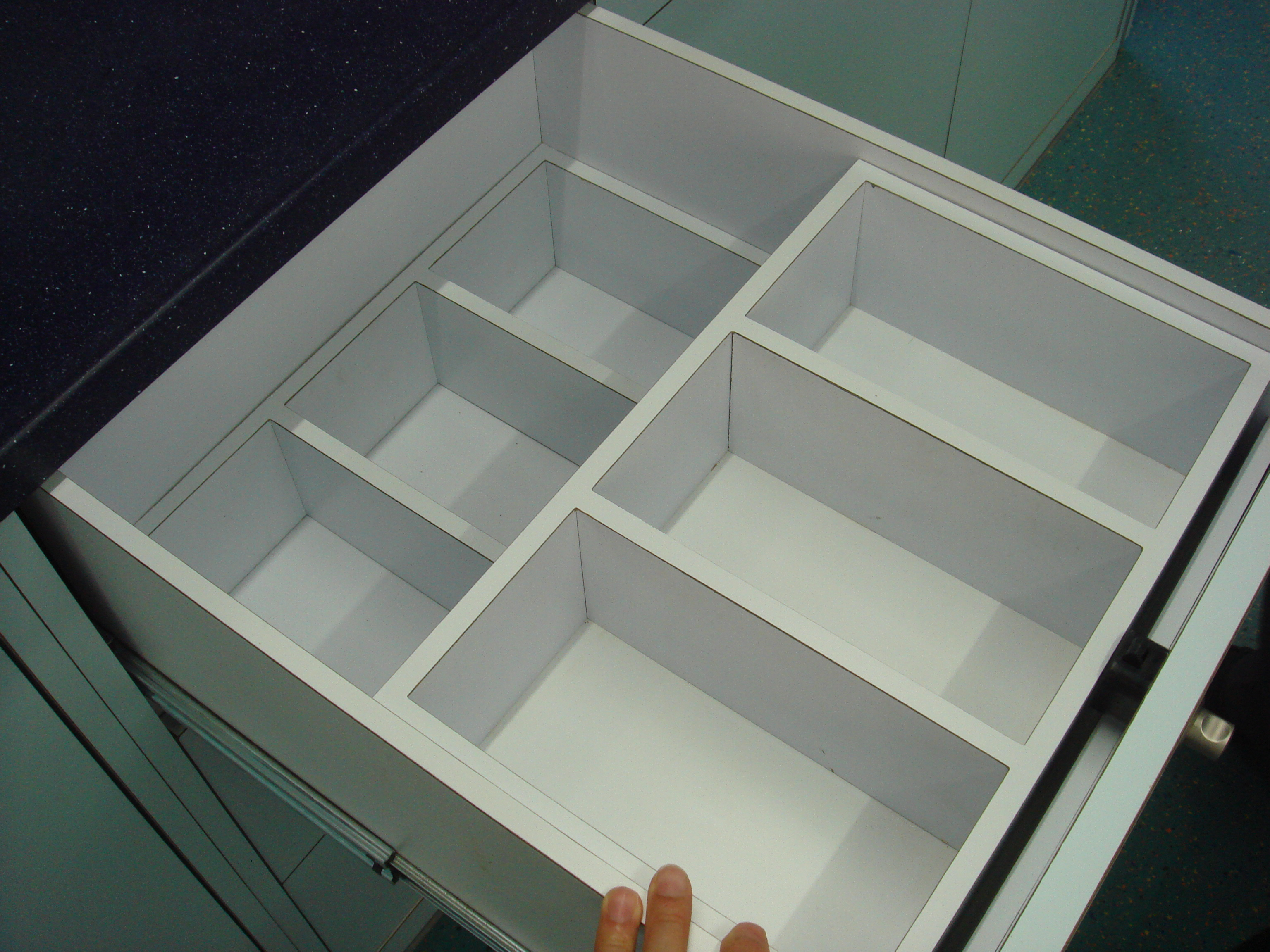 The drawers are all custom built and nicely polished.