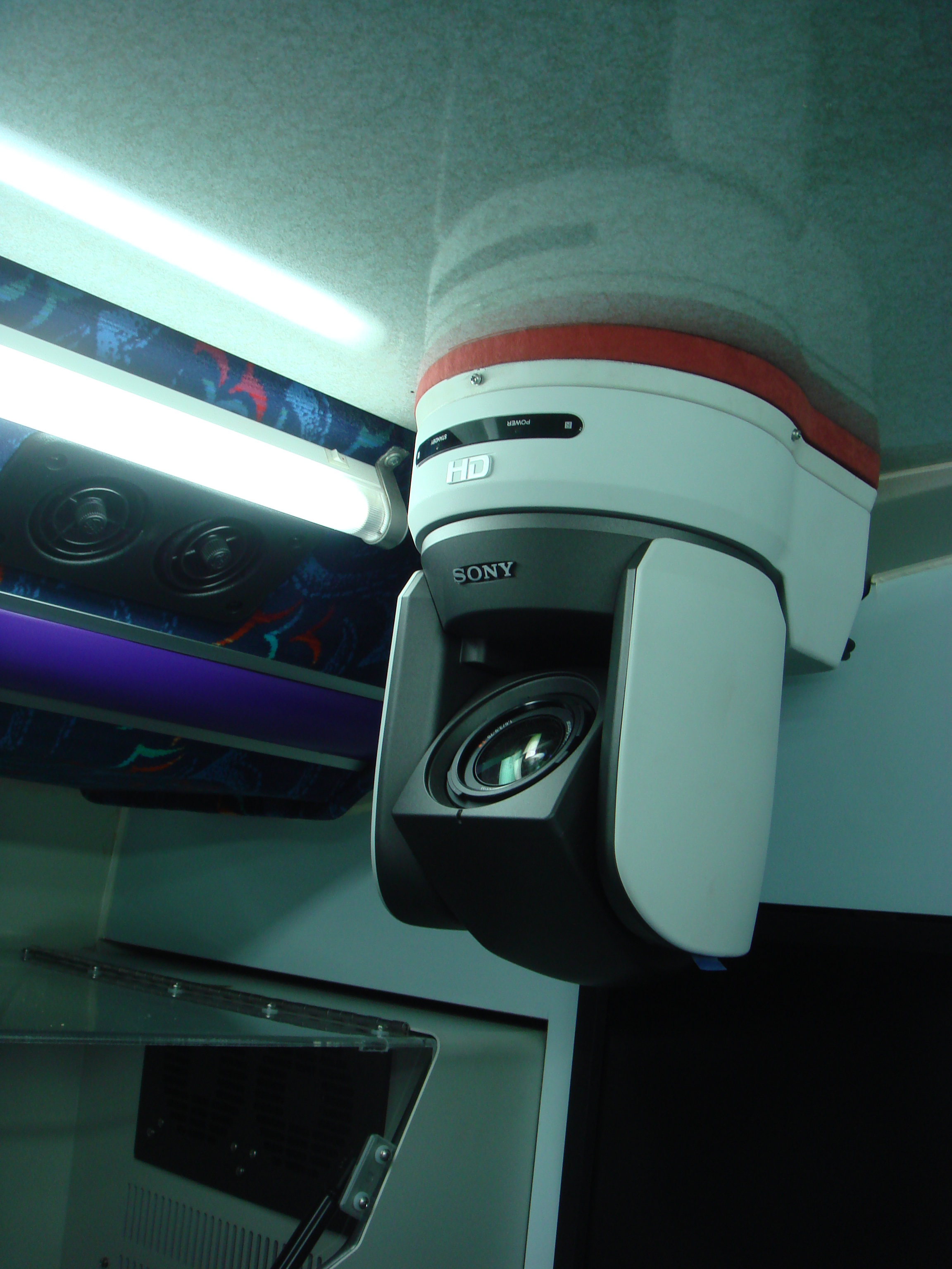 A high definition camera for capturing the demonstration from the teachers, which will be broadcasted to the LCD screens on top of the working stations, as well as a huge LCD TV on the side of the bus for entertaining the public audience.