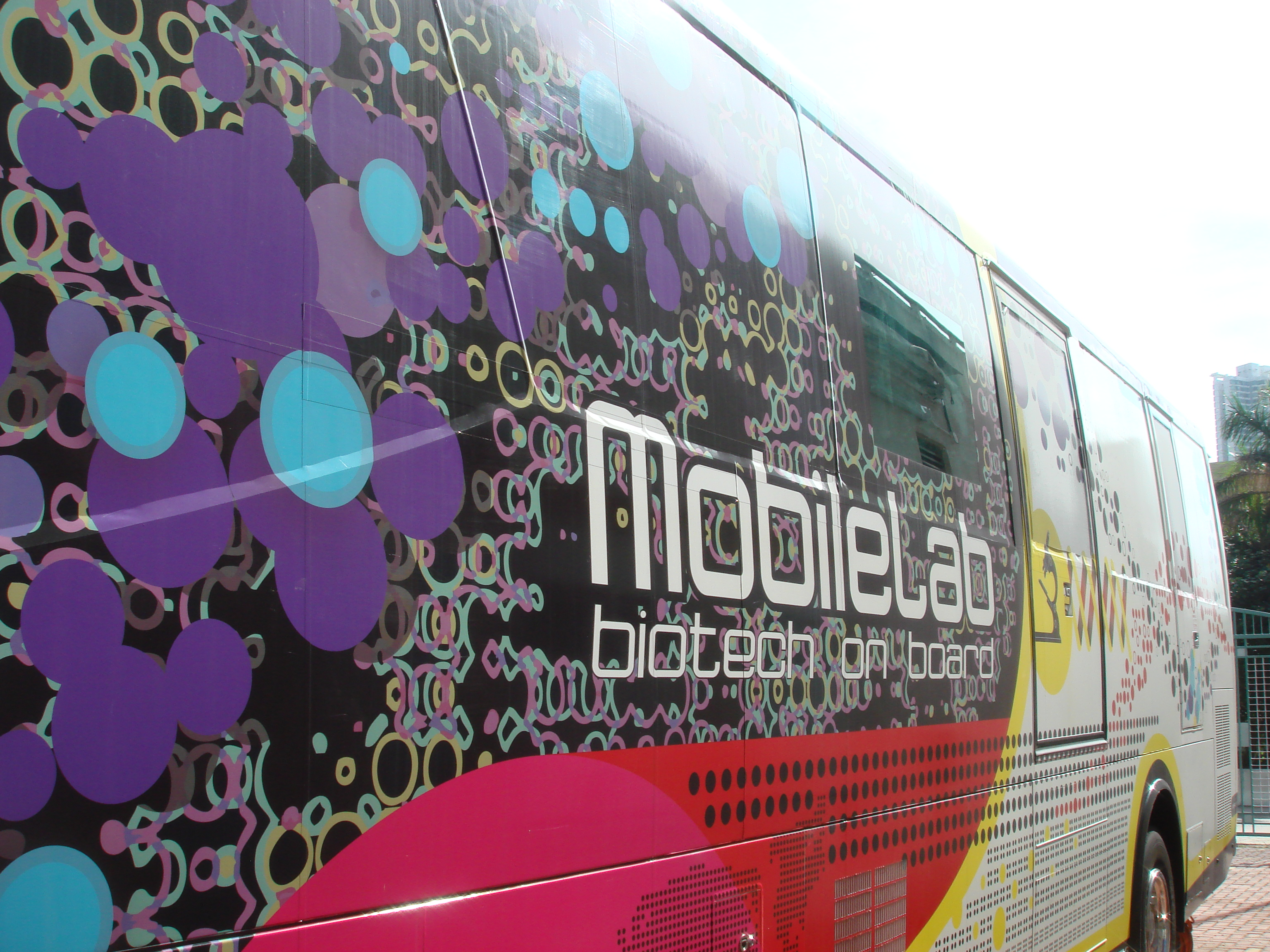 The side of the bus is decorated with nice patterns, and there is a large LCD TV to project the student activities live to the public.