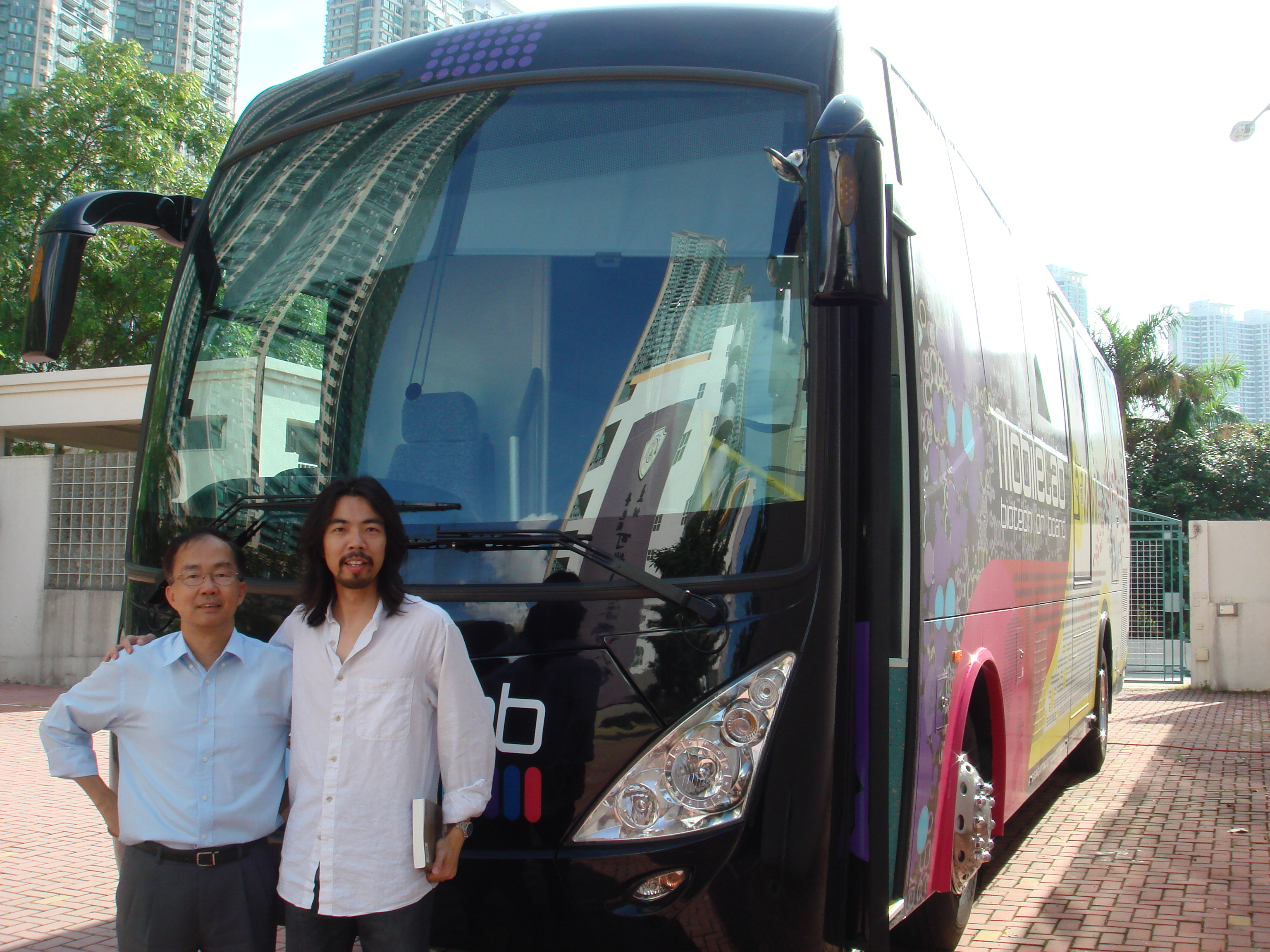 In front of the mobile lab with Dr. William Mak!