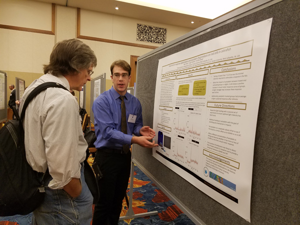 Ryan Wyer presenting his poster.