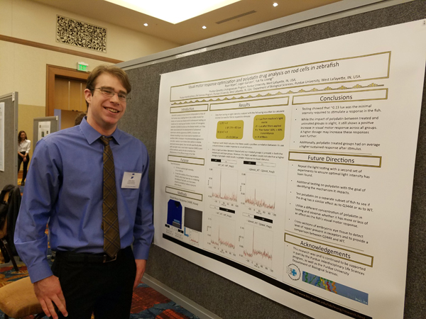Ryan Wyer and his poster