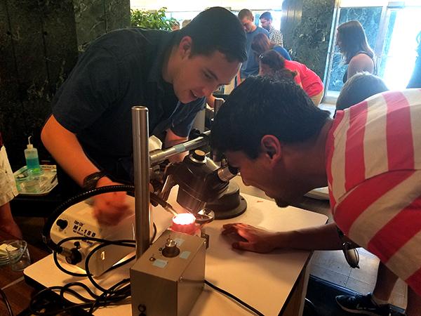 Logan Ganzen demonstrating how to measure zebrafish vision.