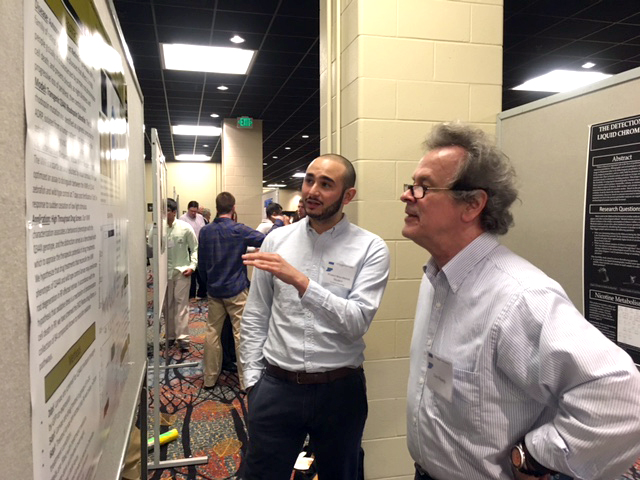 Khaled presenting his research at the IAS meeting.