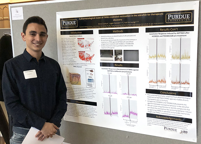 Emre presenting his undergraduate research work.