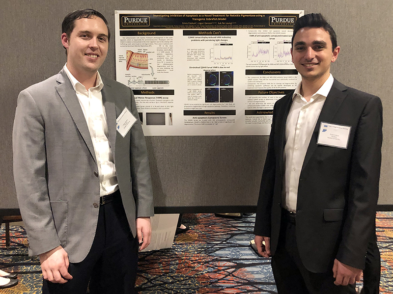 "Emre Coskun (right) presented his work on ""Investigating Inhibition of Apoptosis as a Novel Treatment for Retinitis Pigmentosa using a Transgenic Zebrafish Model""."